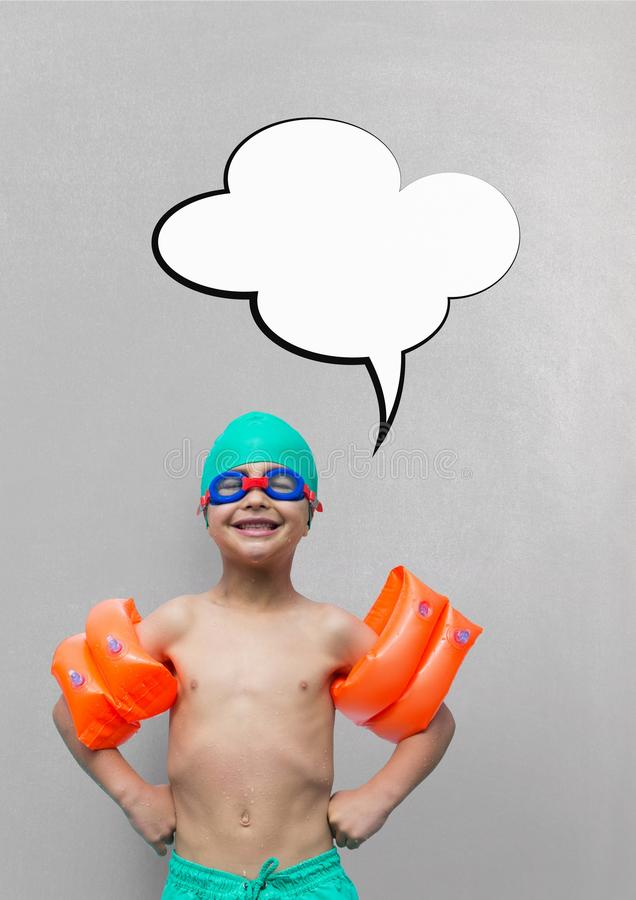 Boy with speech bubble ready to swim against grey background stock photo