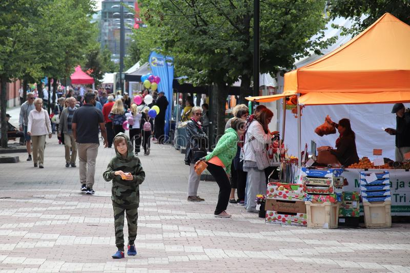 Boy spending time at popular outdoor market. A boy spending time at an outdoor market in Leppävaara urban center of Espoo, Finland. This annual popular event royalty free stock photography