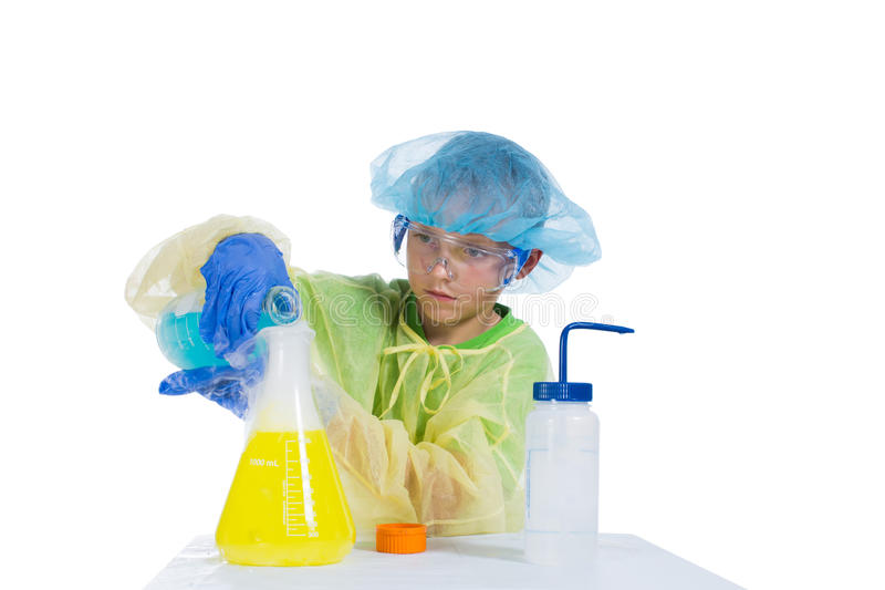 Boy Spends Experiments Mixing Different Fluids And Smoke Gets Stock Photos