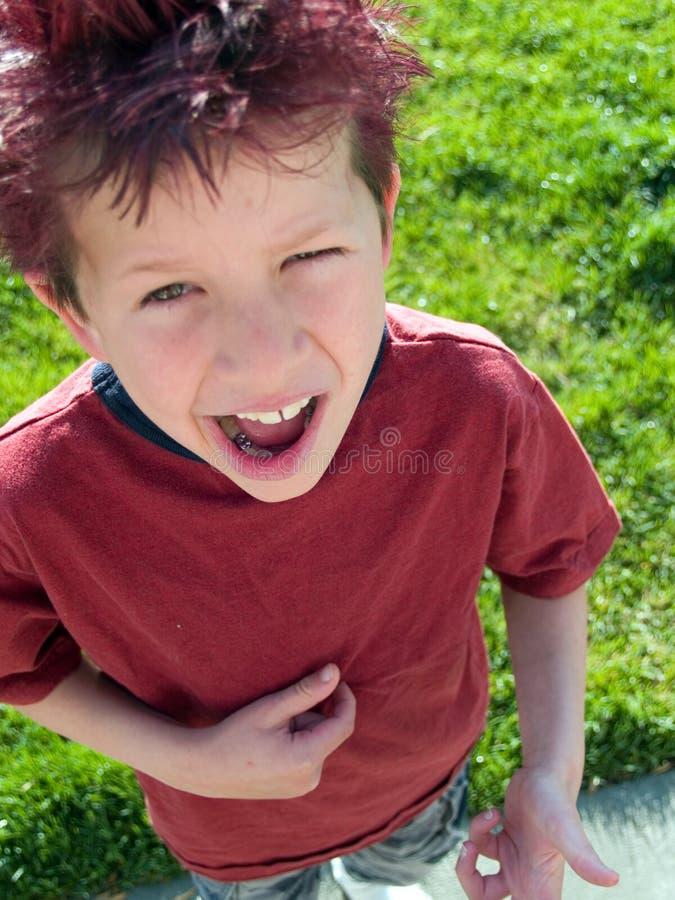 Boy with spiky hair stock photo