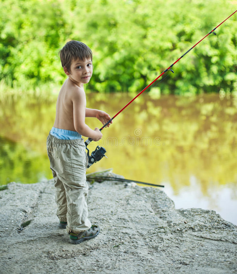 Boy With Spinning Rod Royalty Free Stock Images