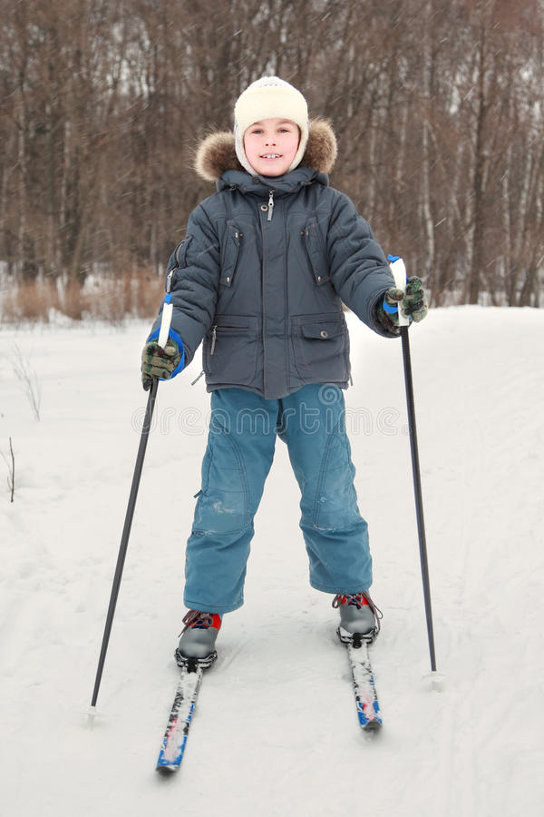 Boy In Sport Dress Skiing At Forest Stock Image
