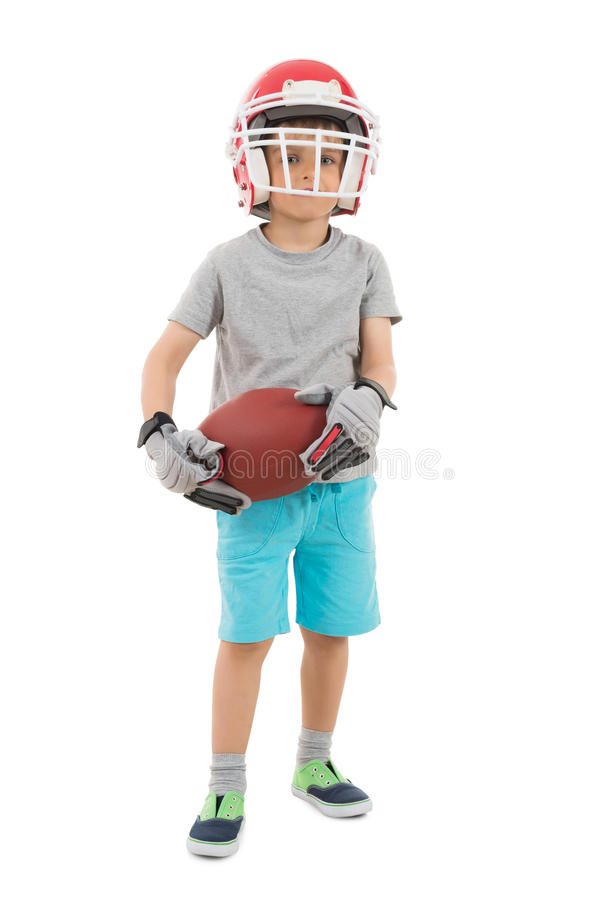 Boy In Sports Helmet Holding Rugby stock photography