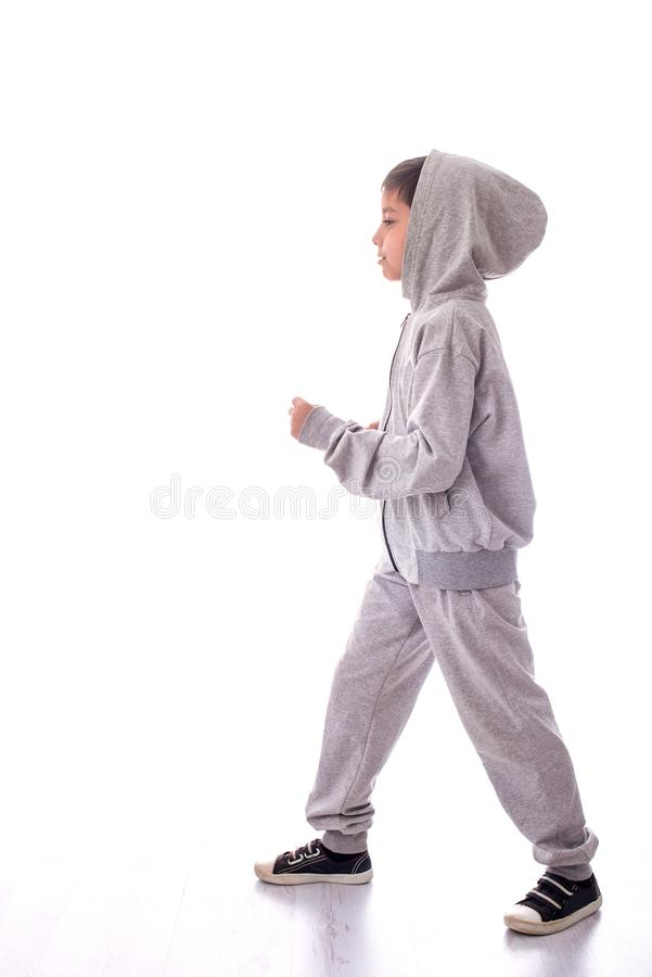 The boy in a sports suit goes. The picture is isolated royalty free stock photos