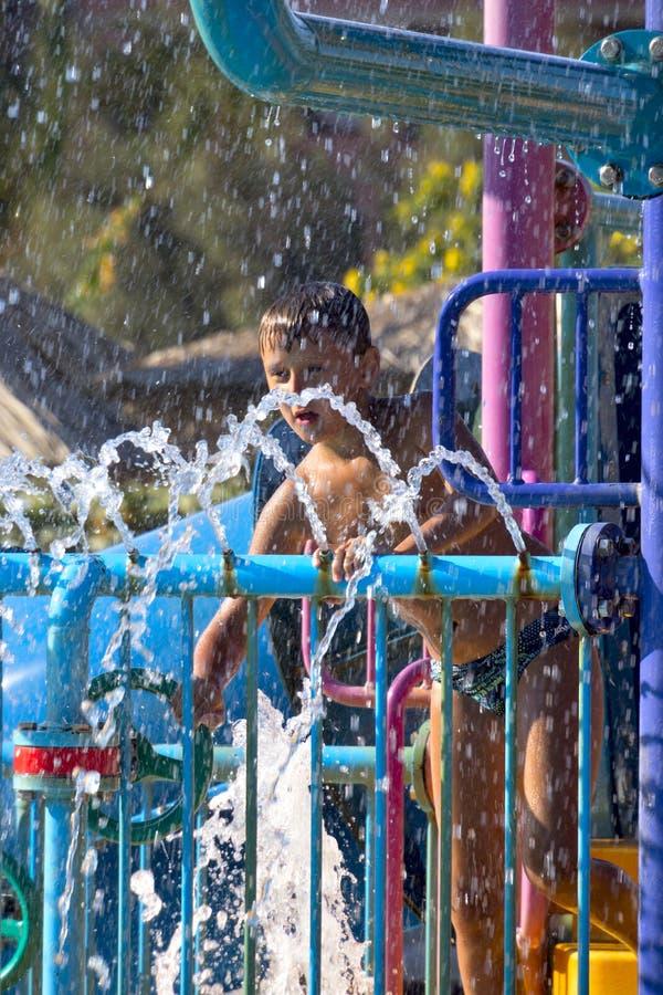 Boy in a spray stock photos
