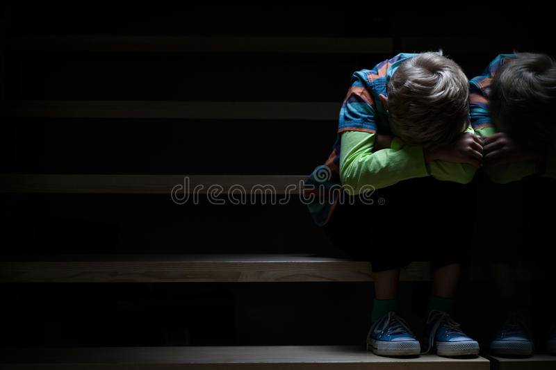 Boy on a stairway at night stock photos