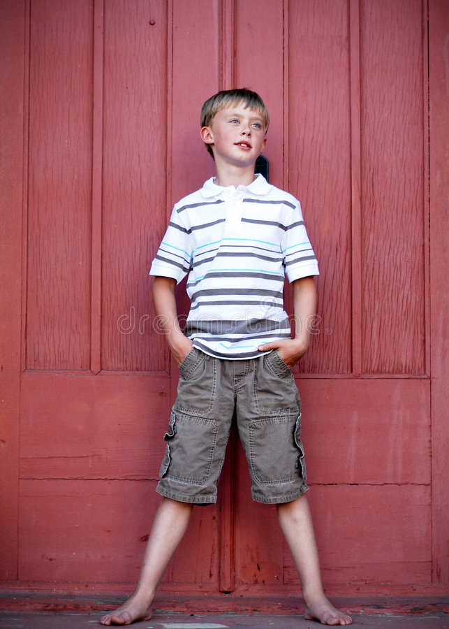 Download Boy Standing Against Red Wall - Vertical Stock Image - Image: 5975547
