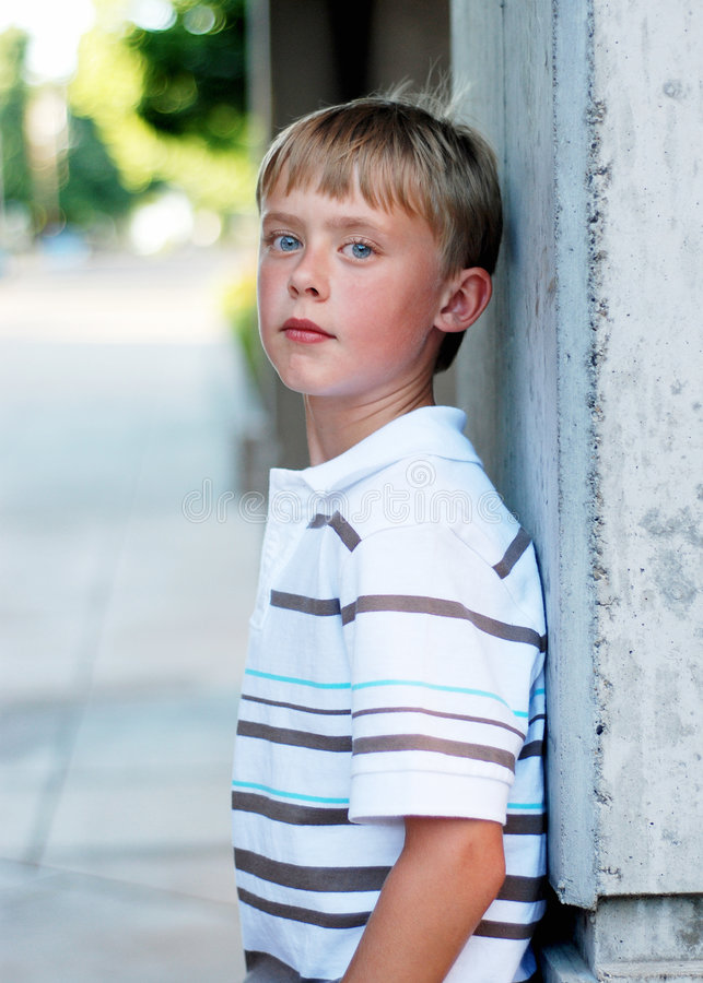 Download Boy Standing Against Wall - Vertical Stock Photo - Image: 5975358