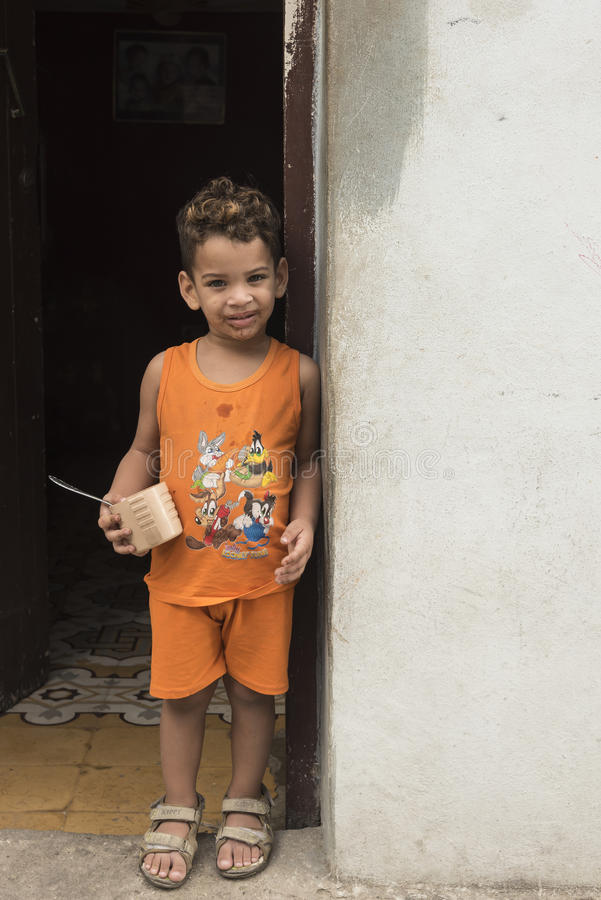 Boy standing in doorway Havana royalty free stock images