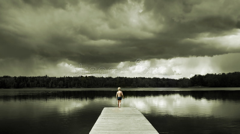 Boy standing on a Footbridge. Alone