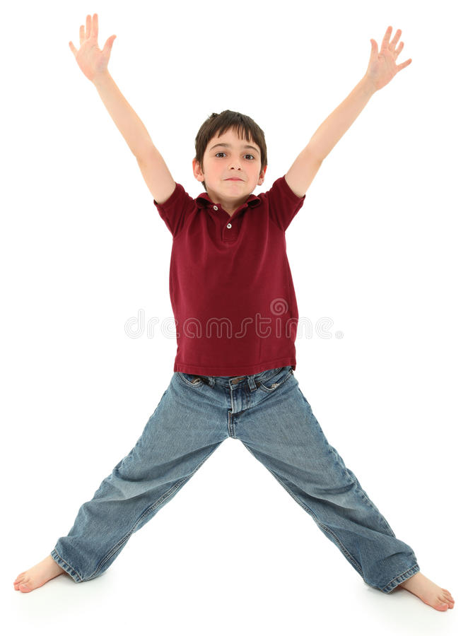 Boy Standing in Letter X Pose. Attractive 8 year old french american boy standing in the shape of a letter x or ready to hug. Standing over white background stock photography