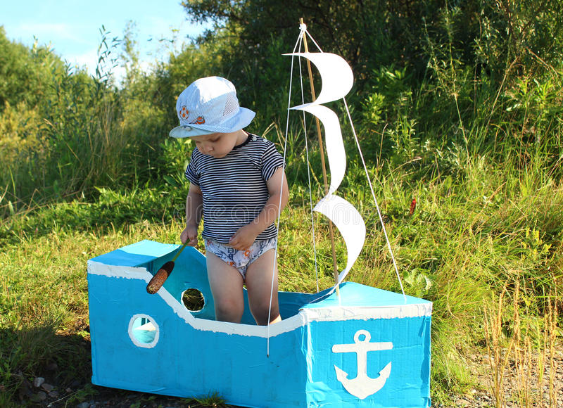 The boy is standing in a makeshift ship royalty free stock photos