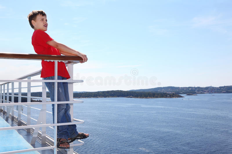 Download Boy Stands On Deck Of Ship And Shouts Stock Photo - Image of full, child: 26337548