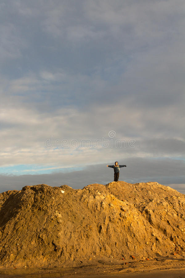 Boy stands on the hill in the early spring. royalty free stock images