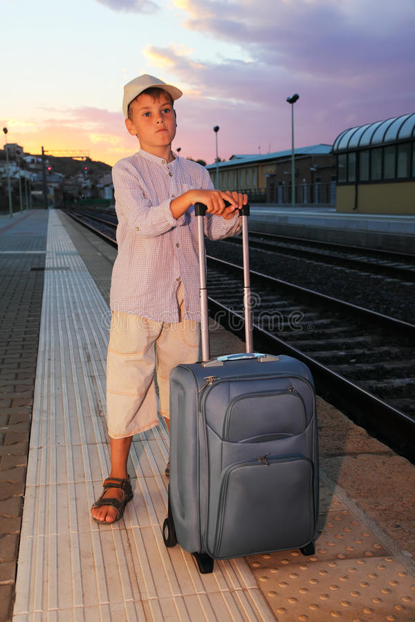 Download Boy Stands On Platform Of Railway With Travel Bag Stock Image - Image: 18595367