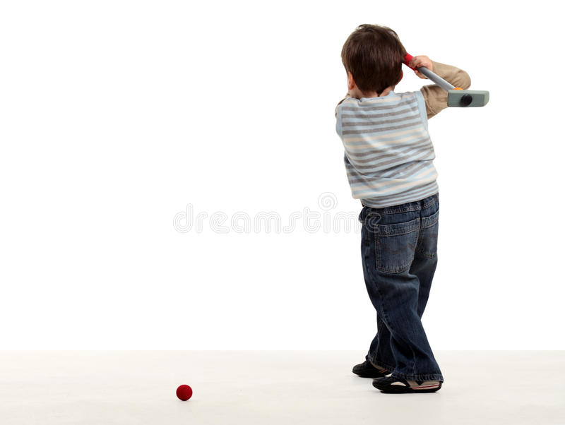 Boy stay back and preparing to hit a golf ball