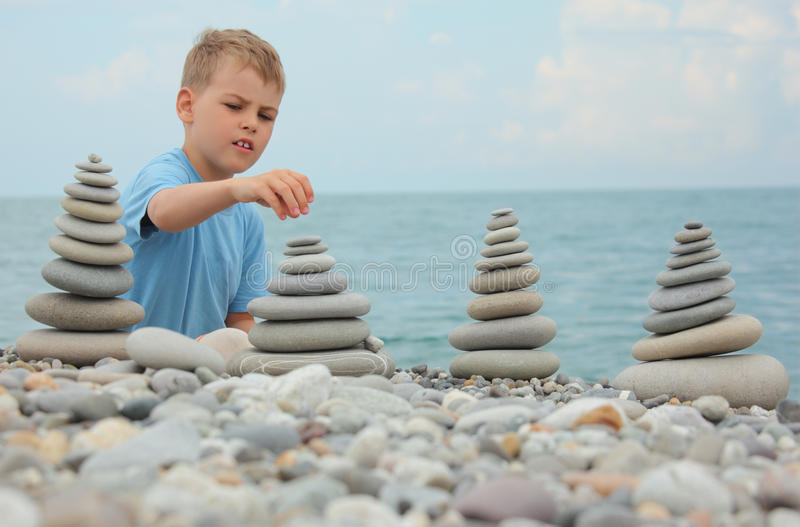 Download Boy And Stone Stacks On Pebble Beach Stock Image - Image of pebble, nature: 10698987