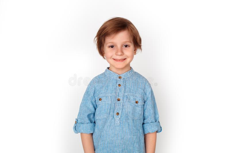 Boy studio standing isolated on grey looking camera happy. Little boy studio standing isolated on grey wall looking camera smiling happy royalty free stock image