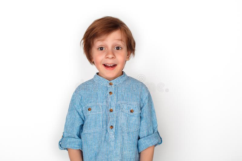 Boy studio standing isolated on grey looking camera impressed. Little boy studio standing isolated on grey wall mouth opened looking camera impressed stock images