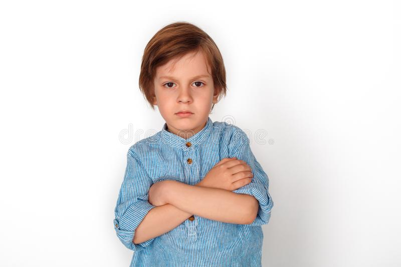 Boy studio standing isolated on grey vrossed arms angry. Little boy studio standing isolated on grey wall crossed arms looking camera angry stock images