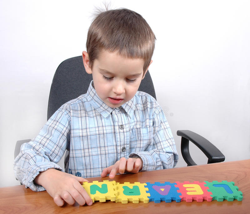 Download Boy study the letters stock photo. Image of puzzle, child - 12302690