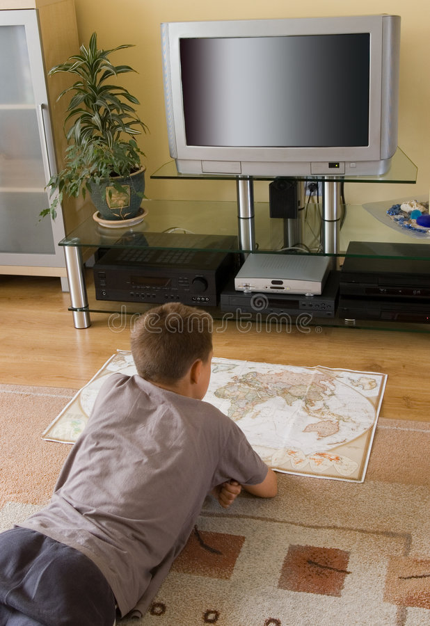 Free Boy Studying A Map Royalty Free Stock Photography - 2868157