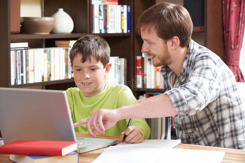 Boy Studying With Home Tutor royalty free stock photo
