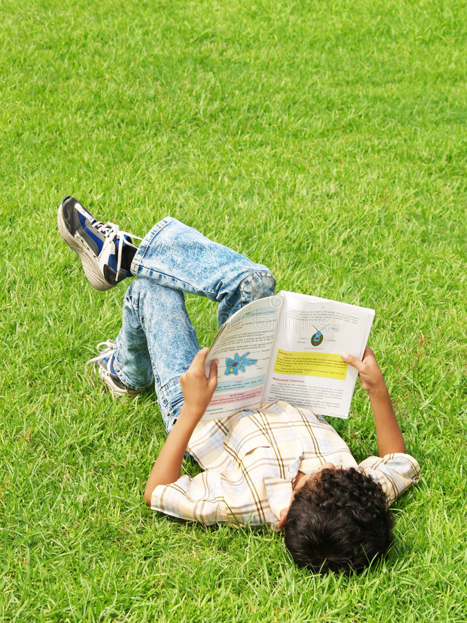 Download Boy Studying Outside Stock Photos - Image: 4040773