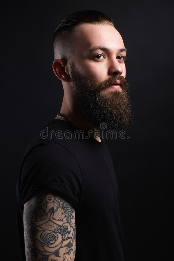 Boy with stylish haircut and tattoo. handsome Man. Tattoed bearded hipster stock images