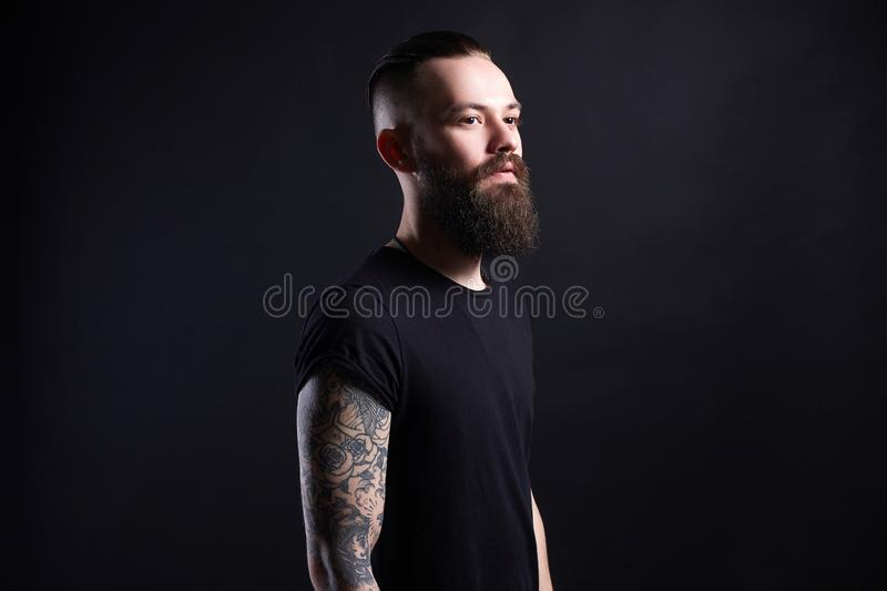 Boy with stylish haircut and tattoo. handsome Man. Tattoed bearded hipster royalty free stock photos