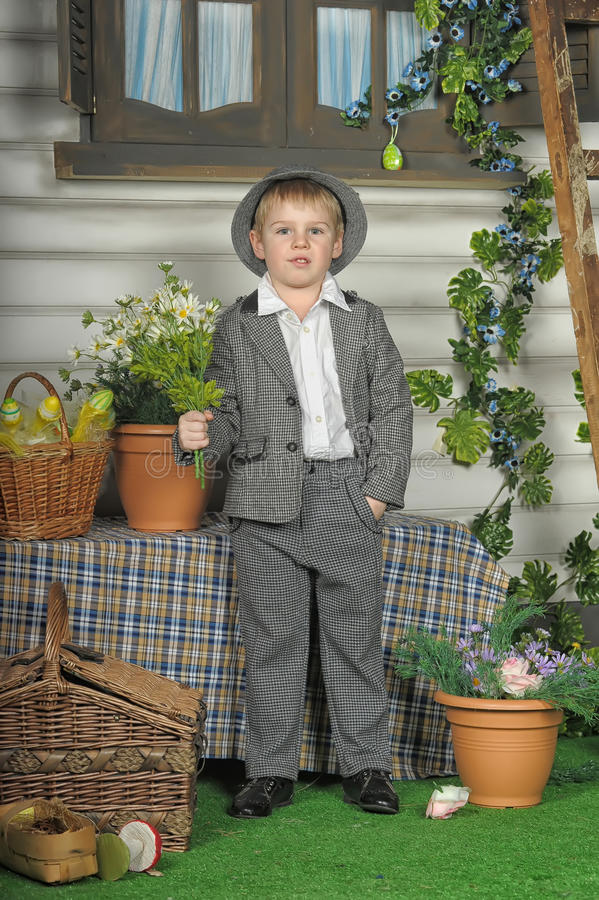 Boy in a suit and a hat royalty free stock images