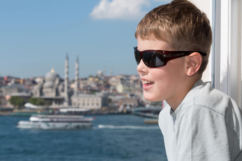 Boy in sunglasses against a landscape stock photography