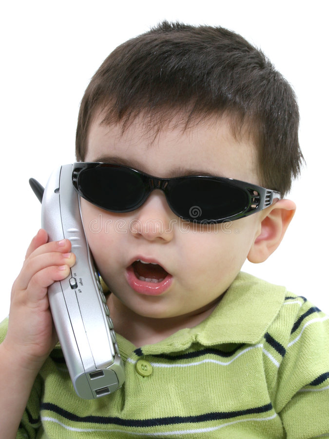 Boy In Sunglasses Speaking On The Phone Over White stock photography