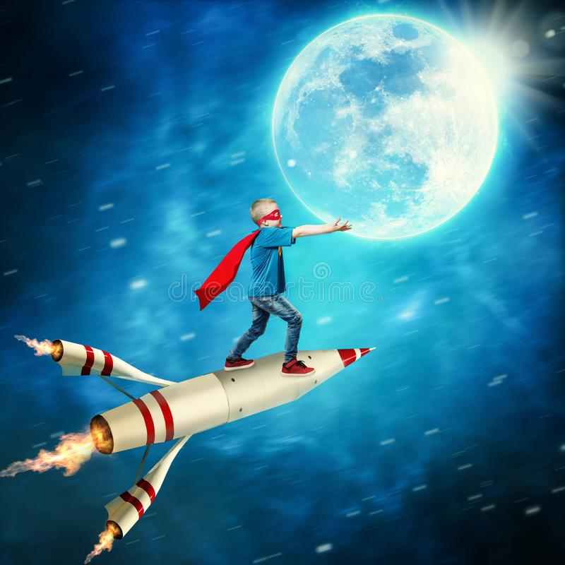 Boy in superhero costume guard the planet. royalty free stock photo