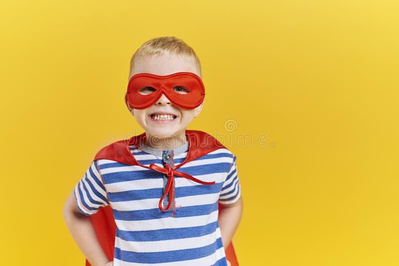 Boy in superhero costume royalty free stock photo