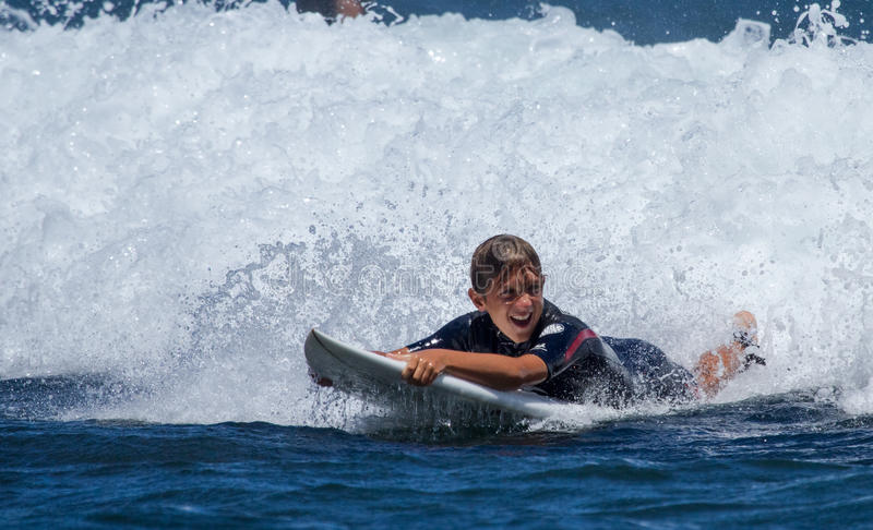 Boy surfing on Maui. royalty free stock photography