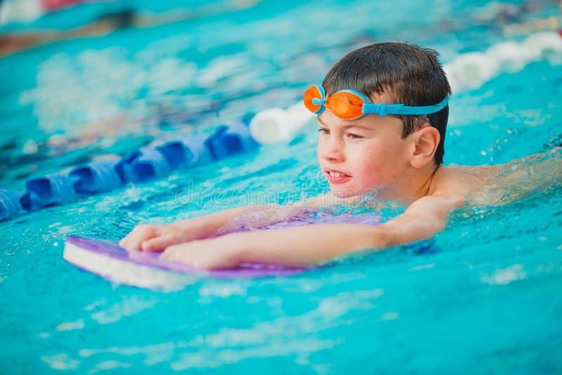 Boy swimming Freestyle stock image
