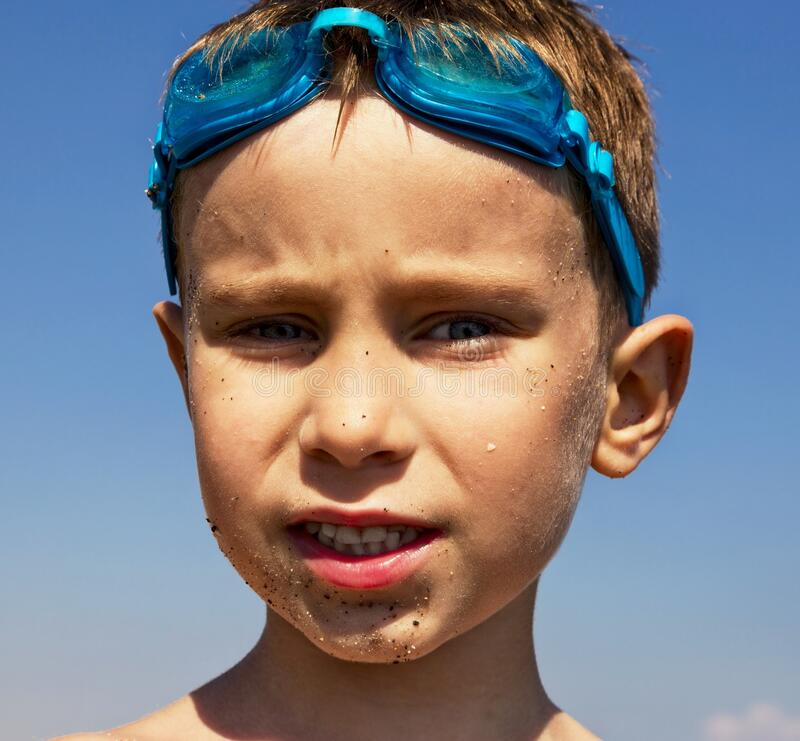 Boy with swimming glasses royalty free stock photo