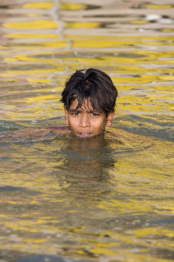 Boy Swimming In The Holy River Ganges - India. Editorial Stock Photo