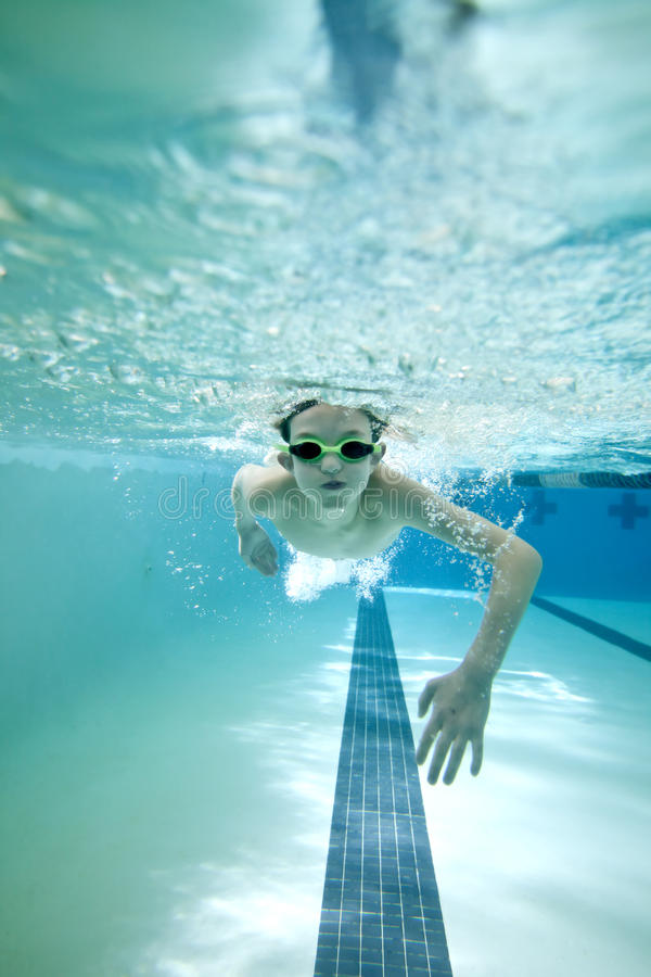 Boy swimming laps royalty free stock images