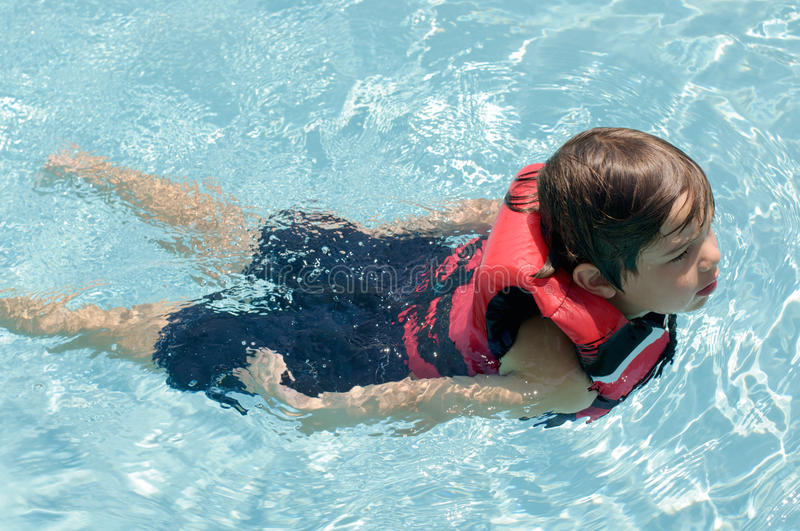 Boy Swimming In Life Vest Stock Photography Image 23939072