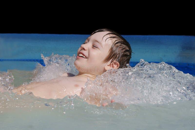 Boy in swimming pool. Small boy in swimming pool; summer fun stock photo