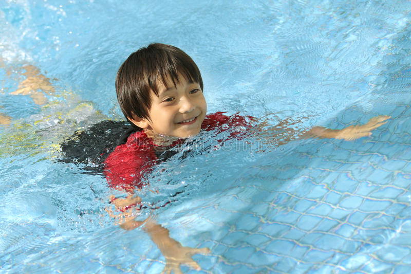 Download Boy swimming in the pool stock image. Image of happiness - 25896611
