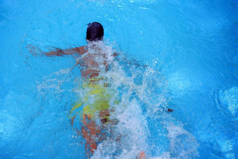 Boy in swimming pool. Boy in the swimming pool royalty free stock photo