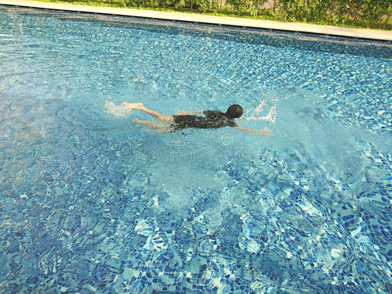 Boy swimming royalty free stock photos
