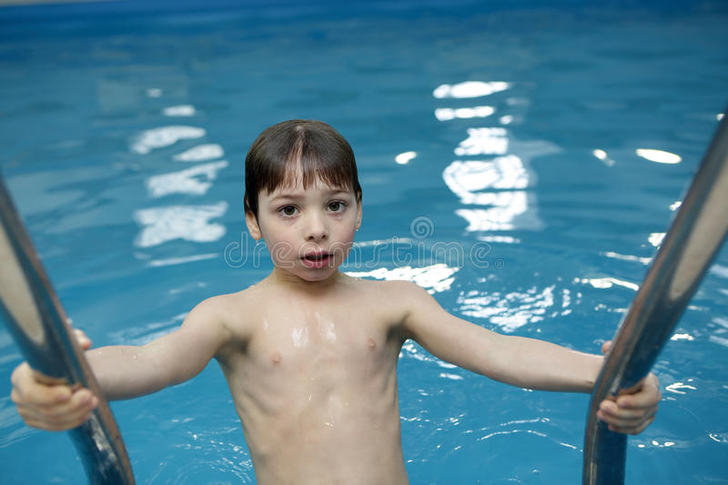 Boy in swimming pool. Portrait of a boy in swimming pool royalty free stock photos