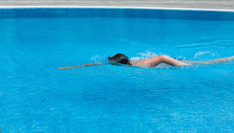 Download A Boy Is Swimming In A Pool. Side View Stock Image - Image: 32888215