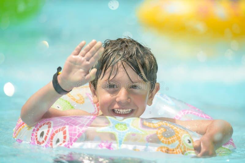 Boy on Swimming Ring stock image