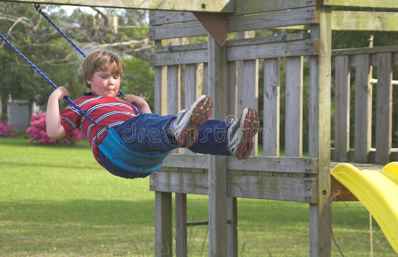 Boy on a Swing royalty free stock photography