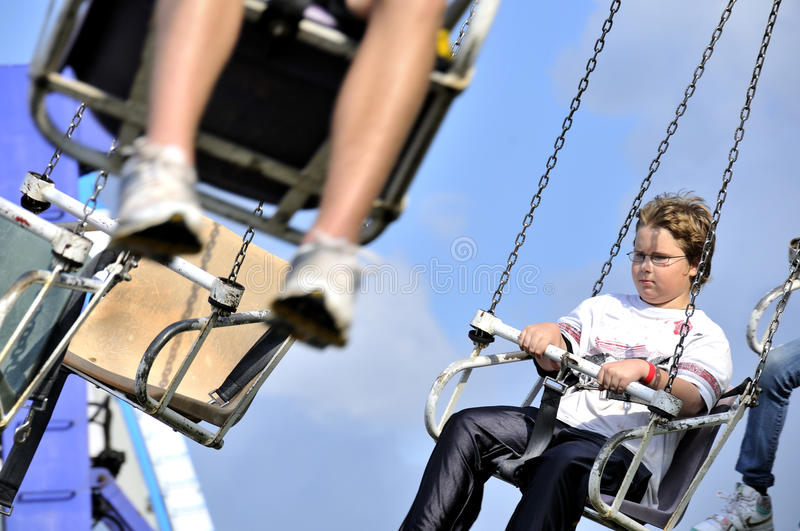 Download Boy on Swing Ride stock photo. Image of festival, midway - 14511486